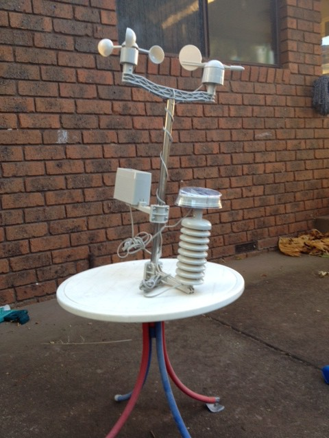 XC3048 weather station set up for testing purposes in the back yard.